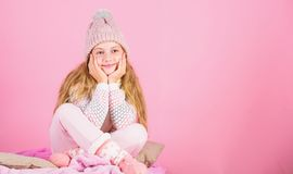 Warm clothes concept. Keep warm and comfortable. Warm accessories that will keep you cozy this winter. Kid girl wear. Knitted hat relaxing pink background stock photos