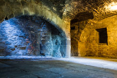 Warm and cold light in stone chamber Stock Photos
