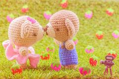 Warm color tone of lovely kiss baby bears crochet doll Stock Photography