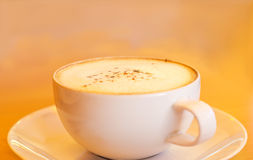 Warm color tone style of coffee on speed paint background, soft and blur Stock Photos