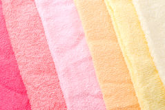 Warm color towels. Background and texture of warm color towels lined diagonally Royalty Free Stock Images