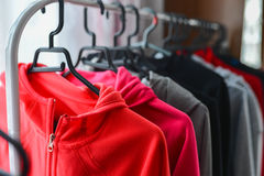 Warm colored sport jackets hanging at a fashion store Stock Images