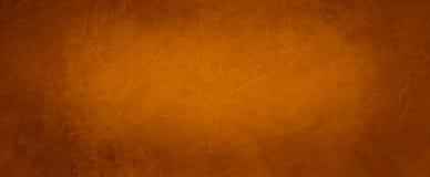 Orange background with old vintage grunge texture and dark borders