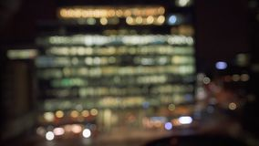Aerial tilt-shift lens over business district working late stock video footage