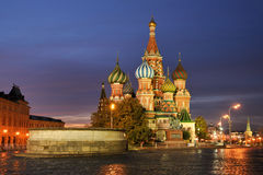 Warm Colors of St. Basil`s Cathedral at Sunrise. View from empty Red Square early morning on Lobnoye Mesto forum place and the amazing St. Basil`s Cathedral when royalty free stock images