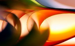 Warm coloured paper abstract background. With a blur effect in the front stock image
