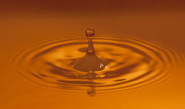 Warm coloured water drop Royalty Free Stock Photo