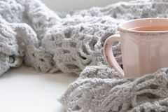 Cozy winter still life: opened book. Warm and comfy autumn or winter concept. Warm and comfy autumn or winter concept. Book, cup of lemon tea and sweater on Stock Photo