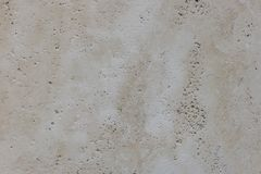 Warm concrete texture photo for background. Shabby chic backdrop. Natural stone surface with drips and dirt. Distressed texture in. Beige shades. Obsolete stock image