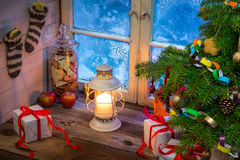 Warm cottage in a Christmas evening. Retro style royalty free stock photos