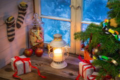 Warm cottage in a Christmas evening. Vintage Warm cottage in a Christmas evening royalty free stock photo