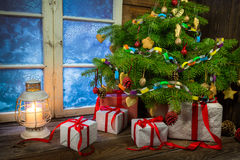 Warm cottage in winter Christmas evening Stock Photo