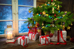 Warm cottage in winter Christmas evening Royalty Free Stock Image