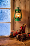 Warm cottage in a winter evening. With frozen window royalty free stock photography