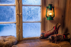 Warm cottage in a winter evening Royalty Free Stock Images