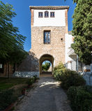 Warm courtyard through archway in Spain Stock Photography