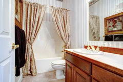 Warm cozy bathroom with curtains Royalty Free Stock Image