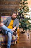 Warm and cozy christmas atmosphere at home. Home is best place. Man bearded hipster relax sit armchair near christmas. Tree. Feel like home. Man mature stock images