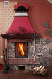 Warm, Cozy Fireplace. A cozy, warm indoor fireplace with a crackling fire blazing stock photo