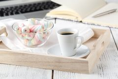Warm cozy home. Tray and cup of coffee with marshmallows Stock Photos