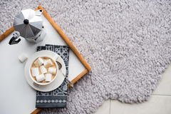 Warm cozy home. Tray and cup of coffee with marshmallows Stock Image