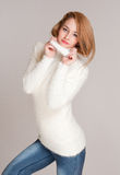 Warm and cozy. Portrait of a beautiful young woman in warm and cozy clothes Stock Photos