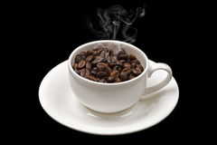 Warm cup of coffee beans Royalty Free Stock Image