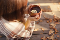 Warm Cup Of Hot Coffee Warming In The Hands Of A Girl, Autumn Outdoors Stock Images