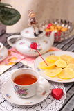 Warm cup of tea and sweets Stock Photography