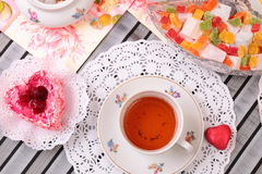 Warm cup of tea and sweets Royalty Free Stock Photos