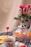 Warm cup of tea and sweets Royalty Free Stock Image