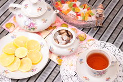 Warm cup of tea and sweets Royalty Free Stock Photo