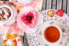 Warm cup of tea and sweets, top view Stock Photography