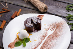 Warm cut chocolate fondant. Warm cut chocolate fondant with ice cream and cinnamon royalty free stock photo