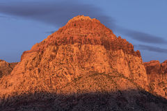 Warm Dawn Light on Rainbow Peak at Red Rock National Conservatio Royalty Free Stock Photos