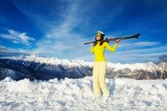 Warm day at ski resort woman over mountain peaks Stock Photo