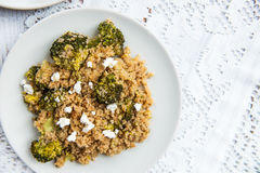 Warm Detox Salad from Quinoa and Broccolli. Warm Detox Salad from Quinoa, Broccolli and pieces of Goat Cheese ot top Royalty Free Stock Photos