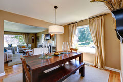 Warm dining room with massive wood table Royalty Free Stock Photo