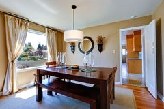 Warm dining room with massive wood table Royalty Free Stock Photos