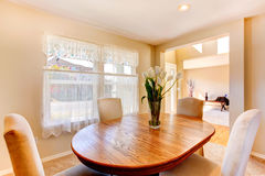 Warm dining room in soft ivory Stock Photography