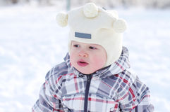 Warm dressed baby age of 1 year in winter outdoors Stock Image