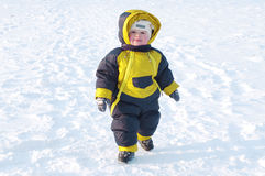 Warm dressed baby walking in winter Stock Photography