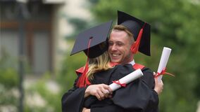 Warm emotions of university friends hugging after diploma awarding ceremony. Stock footage stock video