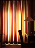Warm evening in the hotel room. Photos in yellow warm tone Royalty Free Stock Images