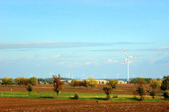 Warm fall day. Fields, fruit trees and windmills on a warm fall day Stock Image