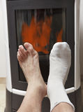 Warm feet in front of fire Royalty Free Stock Photos