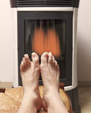 Warm feet in front of fire Royalty Free Stock Photo