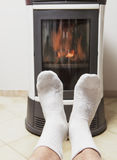 Warm feet in front of fire Stock Photography
