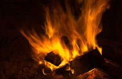 A warm fire in a chimney Royalty Free Stock Images