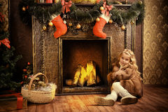 Warm by the fireplace Stock Images